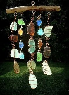 Sun catcher.  The head of each downline is a certain color, dif stones for the people below.  So we would have 7 across.  My parents strand would have 10 pretty stones below her (for her children and grandchildren).  This could be given away as a drawing, or something everyone makes for fun.  Would need enough wire, sticks and stones for the head of each family to make one with their family's help.
