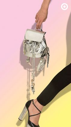 Not only is this Eddie Borgo for Target mini backpack totally of-the-moment with its on-trend shape and silver hue, but it's also customizable. Add your pick of charms or beads from the collection and pair it with black skinny jeans and vintage-inspired platforms. Get ready—the collection launches on July 12! @eborgo