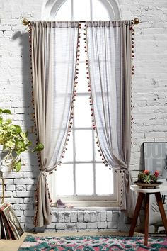 CURTAINS: Sheer fabric with pom-poms