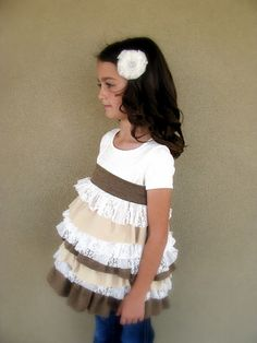 Turn those t-shirt that are to short in to a layered ruffle t-shirt!! How cute is this?? OOOOOH to have a little girl again.