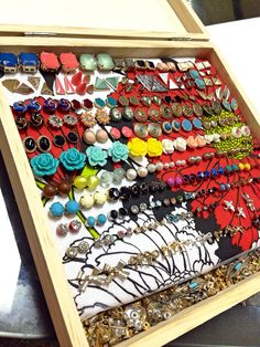 Wooden box from dollar store, styrofoam, and scrap fabric makes a DIY earring storage/display! I left a space along the bottom to keep stud backings:) By Desirea.
