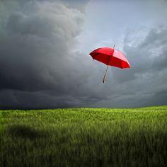 Red umbrella by Carlos Gotay.