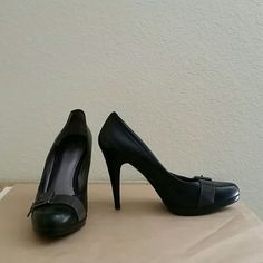 Black Nine West pumps Black professional pumps with metal buckle accent on toe, small platform, very comfortable. Nine West Shoes Heels