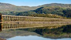 Barmouth railway viaduct, Gwynedd, Wales, UK. The longest wooden bridge in Europe