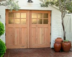 True carriage doors on a painted brick garage. This would convert beautifully to a living space. The doors would open to that excellent brick driveway/patio for indoor/outdoor living Exterior Design, Craftsman Style Homes, Sliding Barn Door Hardware, Custom Garages, Carriage Doors, Building A Garage, Garage Studio, House Exterior, Craftsman Door