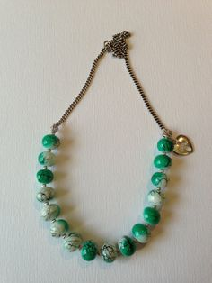 One Of a Kind Handmade Accessories!   Teal and White Beaded Necklace with Silver Heart Charm. $24.50, via Etsy.