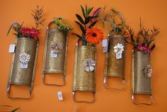 vintage cheese graters turned wall vase.