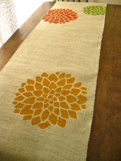 10 Flower Stenciled Burlap Table Runners. $250.00, via etsy - I'll bet mom could make these for a lot less.