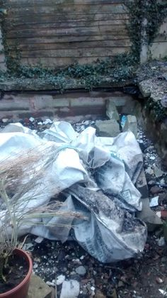 Well it was a pond but now filled with well spare stuff ie stone, tiles, etc and we have the sacks from the soil we had delivered last week just placed here to use later.   Theres a use for everything these sacks wils probably double to cover soil protecting from the weeds.  19/03/2015
