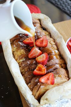 Campfire French Toast by Stacey Ingredients: 1 loaf of bread of choice 1 carton of Burnbrae Farms French Toast Egg Creations ¼ cup sliced almonds 1 500g container of fresh strawberries Confectioners sugar (Icing Sugar) Syrup of choice