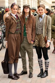 LOVE the one in the middle. More of the Tweed Run. All of these are fabulous in different ways. The ability to pull off GOLD LACE SHORTS with a tweed vest and wool blazer is frankly something I aspire to. Tomboy Fashion, Look Fashion, Fashion Hats, Prep Fashion, Womens Fashion, Bike Fashion, 1920s Fashion Women, Trousers Fashion, Queer Fashion