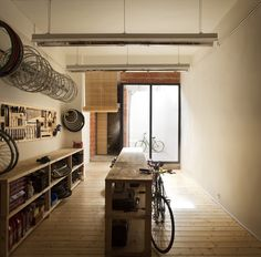 architect hugo mompó has designed the bullit cyclery store in the city of valencia, spain, by reconfiguring an existing building space. Craftsman House Plans, Modern House Plans, Small House Plans, House Floor Plans, Simple Furniture, Design Furniture, Visual Merchandising, Bike Storage Room, Garage Apartment Floor Plans