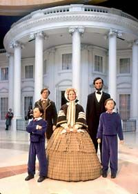 Here stand figures portraying the Lincoln family in 1861. Use your own camera and take a picture of your family standing with them.    Alyssa may pass out!