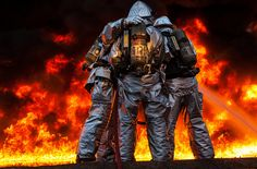 Crash Fire Rescue Marines on Marine Corps Air Station Miramar work together to extinguish flames during their sustainment training. The Marine firefighters must work together in order to be effective at fighting fires when the stakes are high and their own lives and the lives of their counterparts are at stake.  (U.S. Marine Corps photo by Sgt. Aaron Hostutler)
