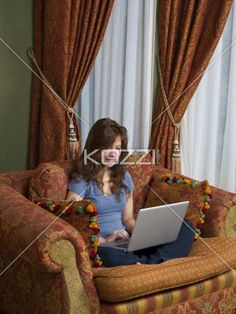 teen on laptop - A teenaged girl on a laptop