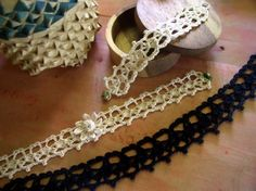 A necklace, choker and bracelet set of crocheted lace.