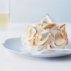 Baked Alaska, the classic, retro dessert, features a layer of cake covered with ice cream and flambéed meringue.