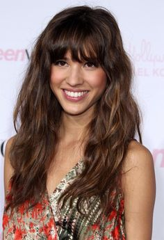 Loose curls with bangs.