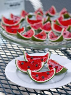 Tiny watermelon Jello shots.    I would rather add tiny black sesame seeds, since the chocolate chips make the watermelon look disproportionate. :P