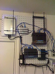 Attach all home network gear to a  pegboard to make it easily accessible and net. Maybe in my office instead of under the stairs?