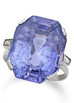 An Art Deco sapphire single-stone ring, circa 1925. The octagonal step-cut sapphire, weighing 25.63 carats, between baguette-cut diamond shoulders. #ArtDeco #ring