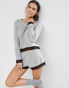 Pijama corto con camiseta de manga larga y ribete de encaje de ASOS 18,99 €23,99 €