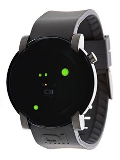 The THE ONE Gamma Ray watch shows the time in a futuristic design, featuring LED lights and a mirrored face. Cool Watches, Watches For Men, Men's Watches, Gamma Ray, The One, Black Face Watch, Mens Digital Watches, Led Watch, Green Led