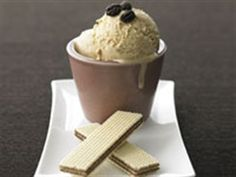 Italian coffee ice-creamIngredients  6 egg yolks  3 cups (750ml) cream (see tip)  ¾ cup (65g) roasted coffee beans  1 cup (220g) caster sugar  chocolate coffee beans  wafers to serve (optional)