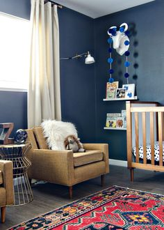 Dark & Moody Nursery with navy walls & a vintage rug // brittanyMakes