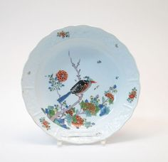 PLATE WITH BIRD TREE DECOR Meissen, ca. 1730/35  Porcelain, decorated in colours and sparingly gold. Bird sitting on a sprig between peony b...