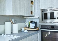 I like how the cabinet extends to the counter top to hide small appliances. The roll out shelf makes it especially convenient.