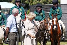 Camilla strokes one of the ponies who will be taking part in the games...