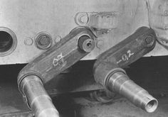 Photo of the spindles attached to the torsion bar suspension during factory assembly on chassis of King Tiger tanks.