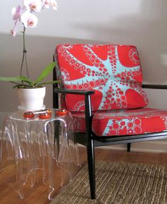 Gorgeous recovered midcentury-style chair in octopus fabric