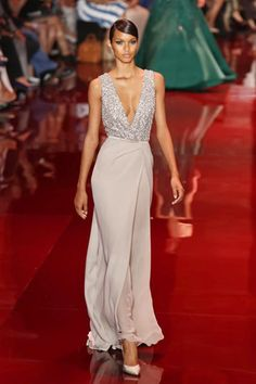On a slick red oval catwalk Elie Saab placed at the heart of the Palais Brongniart in Paris, the designer sent out a collection that was unabashedly ornate.  This was a show of gowns made for m...