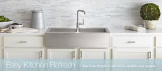 Marble mosaic tile backsplash, white counter and cabinets, stainless steel farmhouse sink