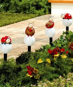 "Solar Yard Lights, Ladybugs Solar Garden Stakes, Set of 4 by ABC. $24.99. A Set of 4 Whimsical Ladybug Solar Stakes brings light and fun to a flower bed or walkway. Each of the globes has a cute ladybug perched on top. A solar panel on a separate stake provides energy for the globes, which light up automatically at night. Use them as a humorous garden decoration or to line a pathway. Each stake measures approx. 12-1/2"" tall. Sets extends 120"" long. Some assembly required.      Cu..."