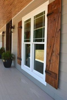 Front porch with custom ceiling, cedar posts, stone columns and wood shutters. Front porch with custom ceiling, cedar posts, stone columns and wood shutters. Window Shutters Exterior, Farmhouse Shutters, Farmhouse Front Porches, Diy Exterior, Exterior Design, Wood Shutters, Ranch Exterior, Wood Siding, Vinyl Siding