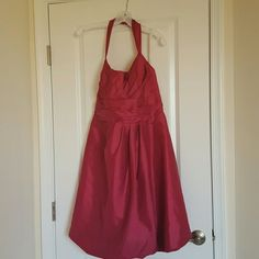 Party Dress Fuchsia dress that comes just above the knee flares out and has a strap around the neck. Worn once. David's Bridal Dresses Mini