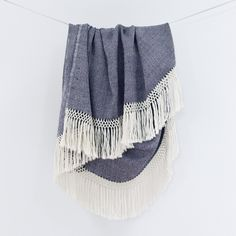 Diamanta Throw // This throw is 100% baby alpaca and the edges are finished with rows of hand-knotted macramé fringe.  The thick weave makes it ideal for chilly nights on the porch or cuddling up on the couch.