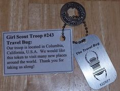 TB157PQ) Travel Bug Dog Tag - Girl Scout Troop #243 Travel Bug