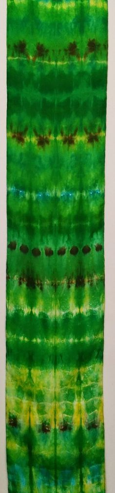 This beautiful shibori scarf is a study in verdant green!  A gorgeous addition to your spring wardrobe!