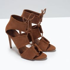 Image 5 of WRAP AROUND LEATHER SANDAL from Zara  449.90 HRK  High-heeled sandals in whisky colored leather. Wide wrap around straps. Stiletto. Lace-up closure on instep.  Heel height of 10 cm.