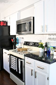 A kitchen transformation: black & white, contemporary and traditional, bright but still warm.