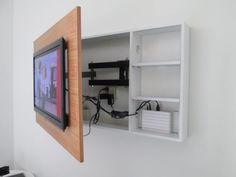 Zo kun je de kabelboel achter de tv mooi wegwerken en de tv onzichtbaar ophangen.
