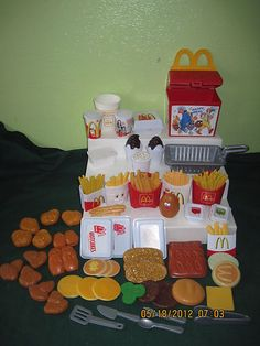 "VINTAGE FISHER PRICE FUN WITH FOOD MCDONALDS PLAY FOOD 65 PIECES- omg!!!! No way!!! I totally had this playset! I loved it! Because of this playset I learned to pronounce burger the right way instead of ""booger"" xD but how is it vintage?? T_T I'm so old"