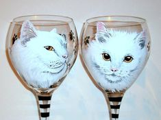 This is a cute hand painted wine glass of a portrait of two of the same cats that I painted for a customer with the name on the back and paw