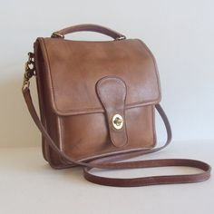Vintage Coach leather crossbody.  I have the best Goodwill shopping mom, and she found this exact purse for 3$!