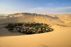 1. The small Peruvian city of Huacachina was built around this beautiful oasis in the middle of the desert.