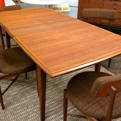large vintage danish teak dining table, refinished, with pull-out